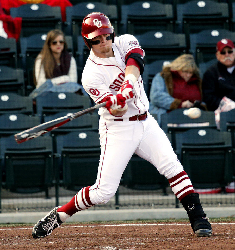 Matt Oberste hits as the University of Oklahoma (OU) Sooners play Hofstra in NCAA college baseball at L. Dale Mitchell Field on Friday, Feb. 15, 2013  in Norman, Okla. Photo by Steve Sisney, The Oklahoman