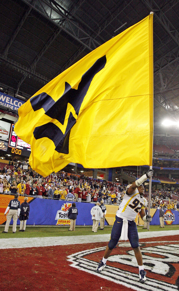 Photo - WVU's Johnny Dingle (92) waves the WVU flag after the Fiesta Bowl college football game between the University of Oklahoma Sooners (OU) and the West Virginia University Mountaineers (WVU) at The University of Phoenix Stadium on Wednesday, Jan. 2, 2008, in Glendale, Ariz. WVU won, 48-28. BY NATE BILLINGS, THE OKLAHOMAN
