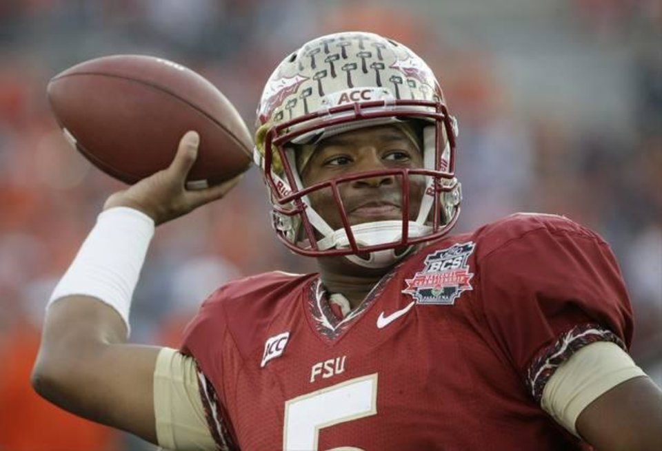 Photo -  Florida State quarterback Jameis Winston warms up before the 2014 national title game against Auburn. (AP Photo)