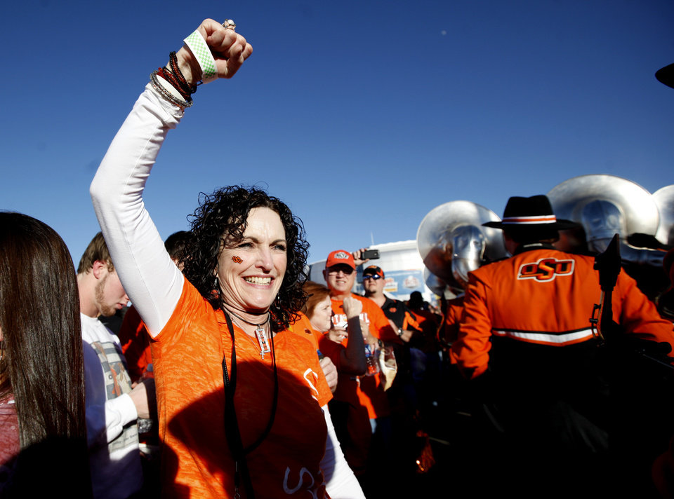 Photo - Oklahoma State fan Debbie Greiner cheers before the Fiesta Bowl between the Oklahoma State University Cowboys (OSU) and the Stanford Cardinal at the University of Phoenix Stadium in Glendale, Ariz., Monday, Jan. 2, 2012. Photo by Sarah Phipps, The Oklahoman