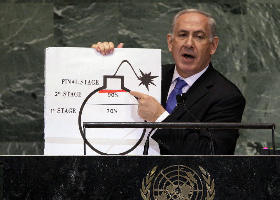 Photo -   FILE - In this Sept. 27, 2012 file photo, Israeli Prime Minister Benjamin Netanyahu shows an illustration as he describes his concerns over Iran's nuclear ambitions during his address to the 67th session of the United Nations General Assembly at U.N. headquarters. As concern intensifies over Iran's nuclear program and the rise of Islamist governments in the Middle East, America's top ally in the region, Israel, has become increasingly wary. Israel's security has been a U.S. foreign policy priority of both Democratic and Republican administrations since the Jewish state was created in 1948. Although small in size and population, Israel has significant influence in Washington and presidents of both parties have pledged their commitment to its defense. And it's always a potential flashpoint in a region that the U.S. depends on for oil. (AP Photo/Richard Drew, File)