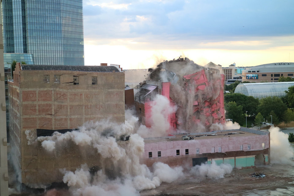 Photo - The Hotel Black in downtown Oklahoma City implodes on Sunday, Sept. 12. Photo by Doug Hoke, The Oklahoman.
