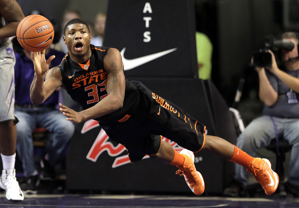 Oklahoma State guard Marcus Smart passes the ball during the first half of an NCAA college basketball game against Kansas State, Saturday, Jan. 5, 2013, in Manhattan, Kan. (AP Photo/Charlie Riedel) ORG XMIT: KSCR103