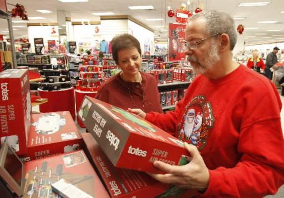 Brad and Shirley Smith look at gift items during early morning Black Friday shopping at the Kohl's store in Midwest City, OK, Friday, November 23, 2012, By Paul Hellstern, The Oklahoman