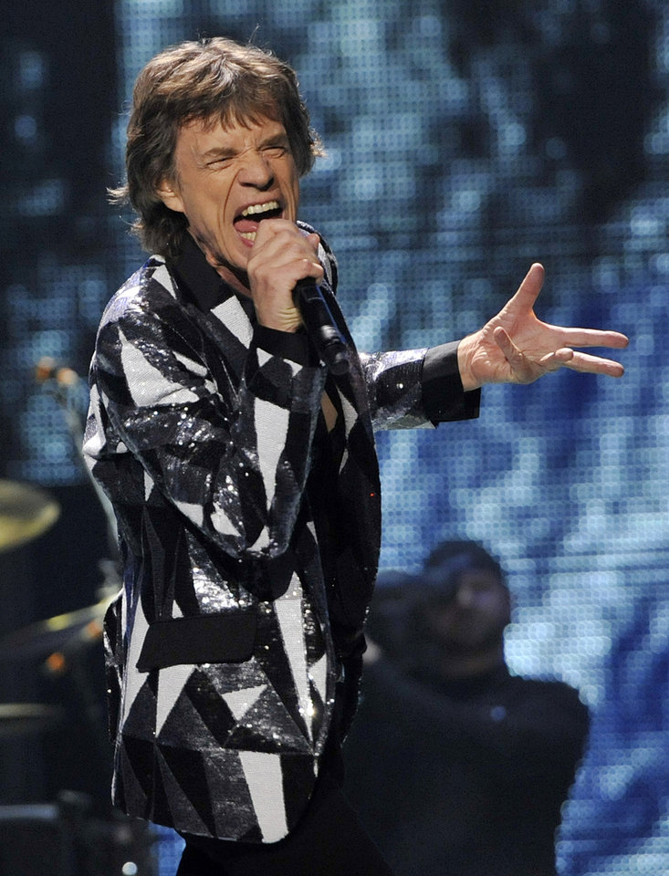 Photo - Mick Jagger of the Rolling Stones performs on the kick-off of the band's