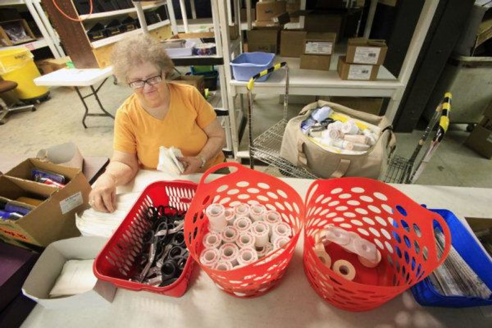NewView employee Joan Kuykendall assembles 50-person first aid kits at NewView (CQ NewView one word) in Oklahoma City Monday. <strong>PAUL B. SOUTHERLAND - PAUL B. SOUTHERLAND</strong>