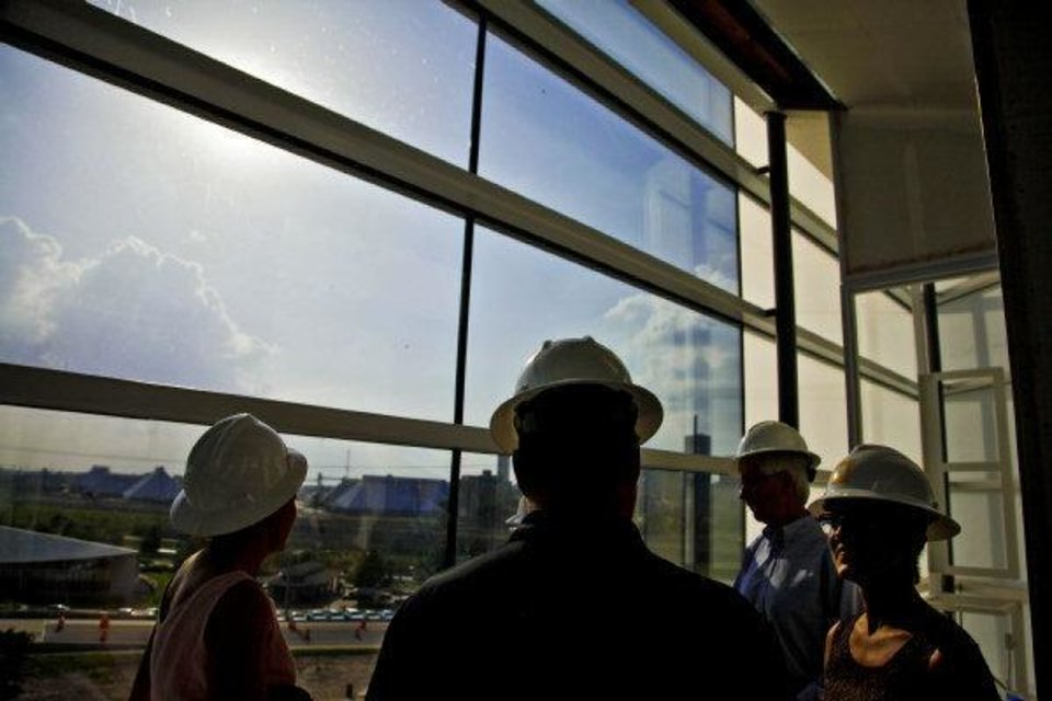 Photo - Participants of a construction tour check out the sights and view from the Chesapeake Finish Line Tower as construction continues on the Oklahoma River on, Tuesday, May 31, 2011. Photo by Chris Landsberger, The Oklahoman ORG XMIT: KOD