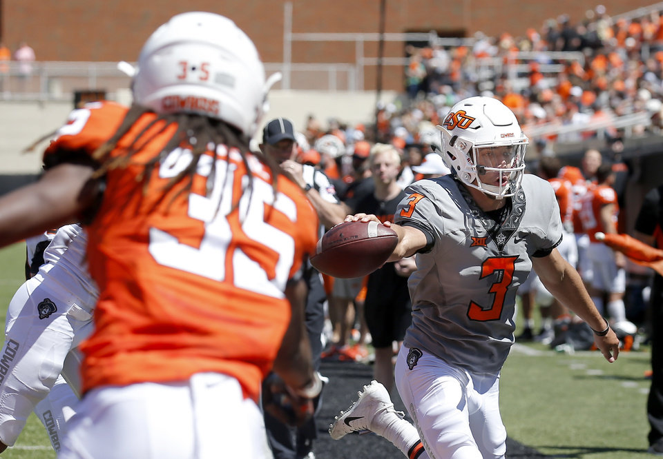 Photo - Oklahoma State's Spencer Sanders (3) attempts to score in a 2-minute drill during the Oklahoma State Cowboys spring practice at Boone Pickens Stadium in Stillwater, Okla., Saturday, April 20, 2019.  Photo by Sarah Phipps, The Oklahoman