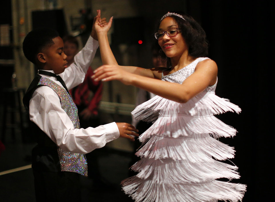 Photo - Andre Crawford, left, and Asia Miller practice backstage Thursday before the LifeChange Ballroom competition at the Rose State Performing Arts Theatre in Midwest City.  Photos by Sarah Phipps,  The Oklahoman  Sarah PHIpps -  Sarah Phipps
