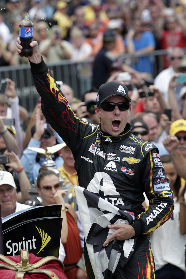 Photo - Jeff Gordon celebrates after winning the NASCAR Brickyard 400 auto race at Indianapolis Motor Speedway in Indianapolis, Sunday, July 27, 2014. (AP Photo/AJ Mast)