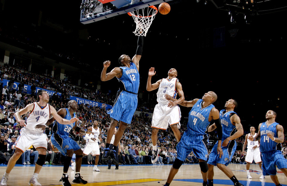 Orlando's Dwight Howard tries to grab a rebound in front of Oklahoma City's Russell Westbrook during the NBA basketball game between the Oklahoma City Thunder and the Orlando Magic at the Ford Center in Oklahoma City, Wednesday, Nov. 12, 2008. BY BRYAN TERRY, THE OKLAHOMAN
