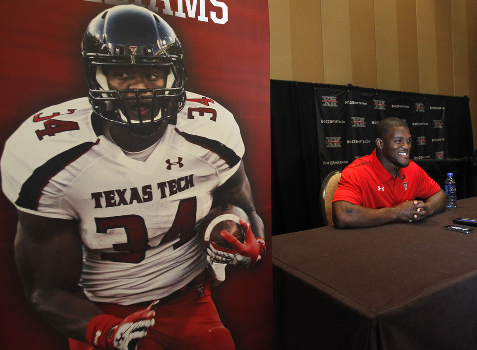 Texas Tech running back Kenny Williams conducts interviews during a breakout session at the Big 12 Conference Football Media Days Monday, July 22, 2013 in Dallas.  (AP Photo/Tim Sharp)