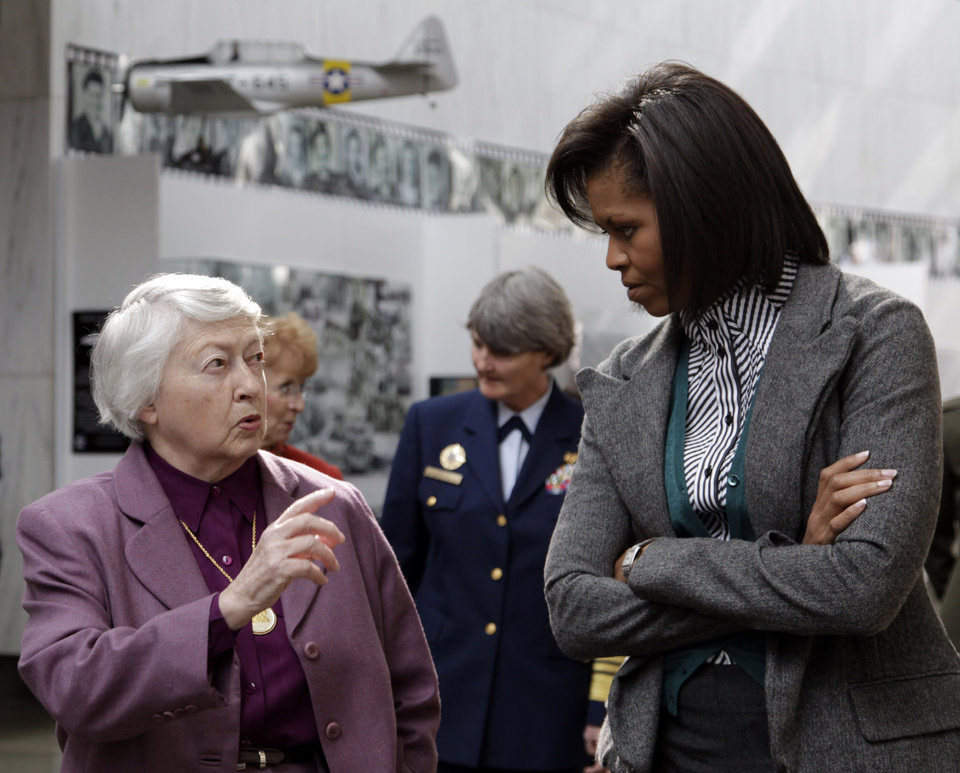 FILE - This March 3, 2009 file photo shows first lady Michelle Obama listening to Retired Brig. Gen. Wilma L. Vaught , president of Women in Military Service for America Memorial Center, during a tour of the center in Arlington, Va. Women served and died on the nation's battlefields from the first. They were nurses and cooks, spies and couriers in the Revolutionary War. Some disguised themselves as men to fight for the Union or the Confederacy. Yet the U.S. military's official acceptance of women in combat took more than two centuries. New roles for females were doled out fitfully _ whenever commanders got in a bind and realized they needed women's help. A look at milestones on the way to lifting the ban on women in ground combat.  (AP Photo/Alex Brandon, File)