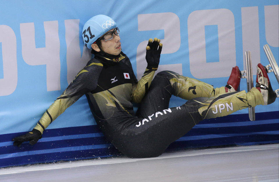 Photo - Satoshi Sakashita of Japan crashes out in a men's 500m short track speedskating quarterfinal at the Iceberg Skating Palace during the 2014 Winter Olympics, Friday, Feb. 21, 2014, in Sochi, Russia. (AP Photo/Bernat Armangue)