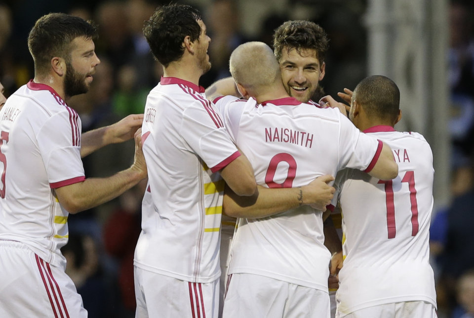 Photo - Scotland's Charlie Mulgrew, second right, celebrates after scoring a goal during the international friendly soccer match between Nigeria and Scotland at Craven Cottage Stadium in London, Wednesday, May 28, 2014. Nigeria will be in Group F in the upcoming World Cup in Brazil (AP Photo/Kirsty Wigglesworth)