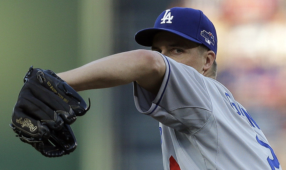 Photo - Los Angeles Dodgers starting pitcher Zack Greinke throws the Atlanta Braves in the second inning of Game 2 of the National League division series, Friday, Oct. 4, 2013, in Atlanta. (AP Photo/Mike Zarrilli)