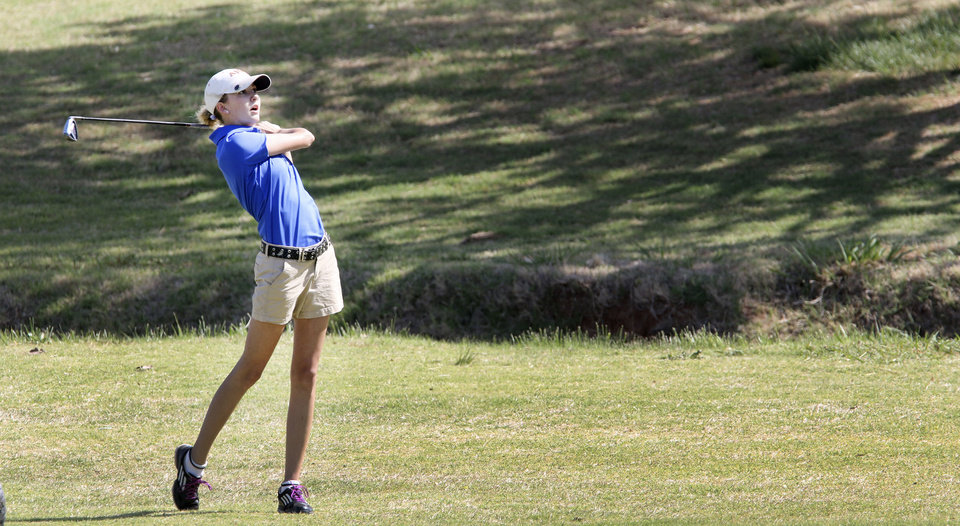 Photo - Harrah junior Tori Plumley watches her fairway shot at Lake Hefner golf course in Oklahoma City,  Wednesday May 07, 2014. Photo By Steve Gooch, The Oklahoman