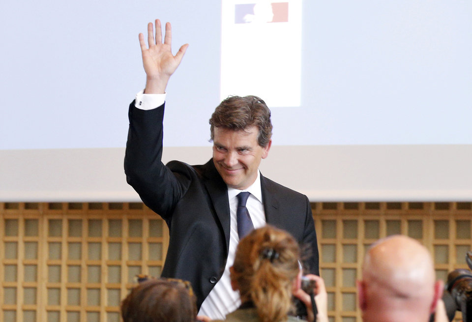 Photo - Economy Minister Arnaud Montebourg waves during a press conference in Paris, Monday, Aug.25, 2014. France's Socialist government dissolved on Monday after open feuding in the Cabinet over how much cutting _ or spending _ will revive the country's stagnant economy. The country is under pressure from the 28-nation European Union to get its finances in order, but Economy Minister Arnaud Montebourg has questioned whether austerity will really kick start French growth.  (AP Photo/Christophe Ena)