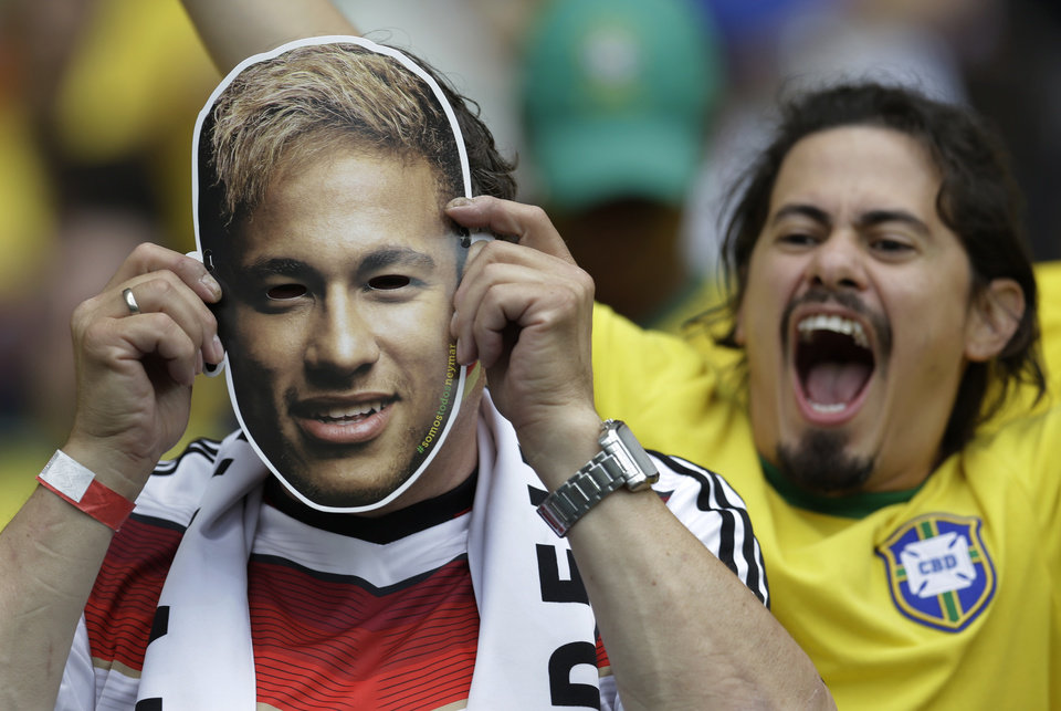 Photo - A Germany supporter puts a Neymar mask in front of his face before the World Cup semifinal soccer match between Brazil and Germany at the Mineirao Stadium in Belo Horizonte, Brazil, Tuesday, July 8, 2014. (AP Photo/Natacha Pisarenko)