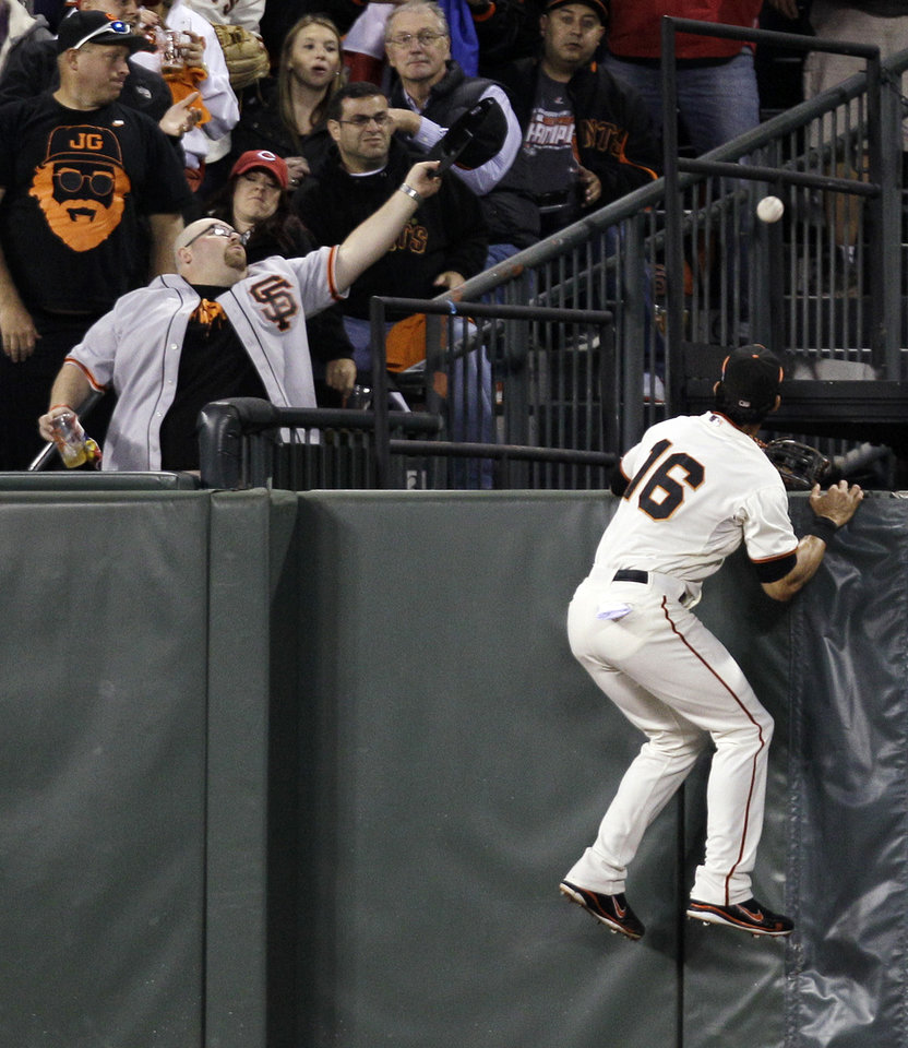Photo -   San Francisco Giants center fielder Angel Pagan (16) can't get to the ball after Cincinnati Reds' Ryan Ludwick hit a solo home run in the second inning during Game 2 of the National League division baseball series in San Francisco, Sunday, Oct. 7, 2012. (AP Photo/Eric Risberg)