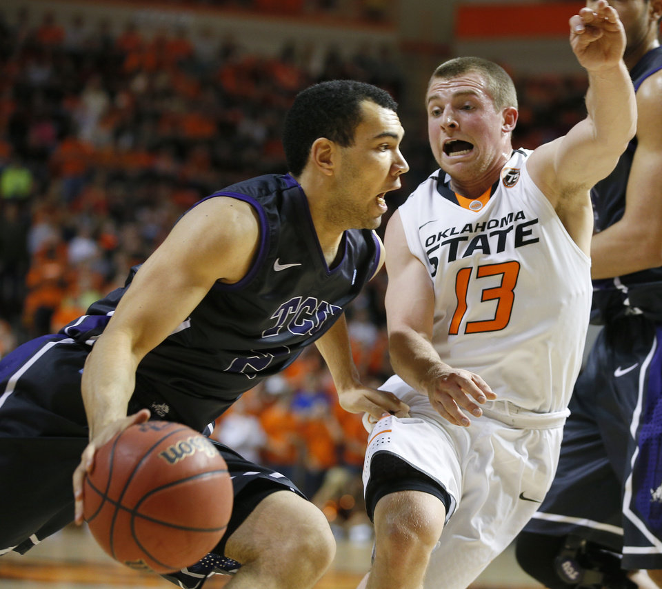 Photo - Oklahoma State's Phil Forte (13) defends TCU's Hudson Price (21) during an NCAA college basketball game between Oklahoma State University (OSU) and TCU at Gallagher-Iba Arena in Stillwater, Okla., Wednesday, Jan. 15, 2014.  Photo by Bryan Terry, The Oklahoman