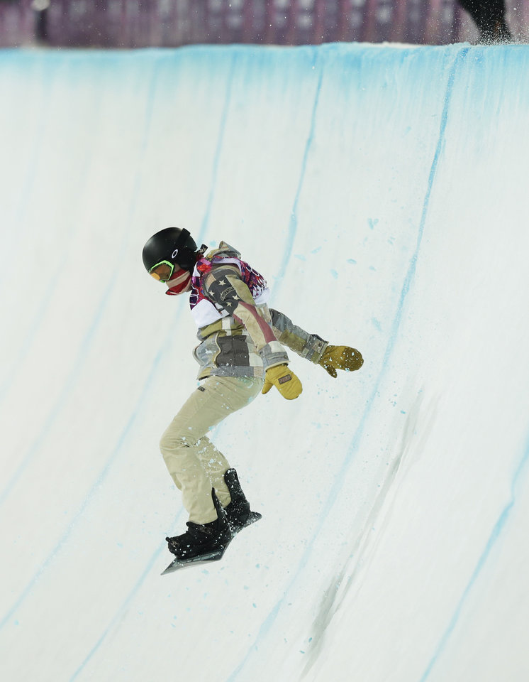 Photo - Shaun White of the United States bounces off the edge of the half pipe during the men's snowboard halfpipe final at the Rosa Khutor Extreme Park, at the 2014 Winter Olympics, Tuesday, Feb. 11, 2014, in Krasnaya Polyana, Russia. (AP Photo/Andy Wong)