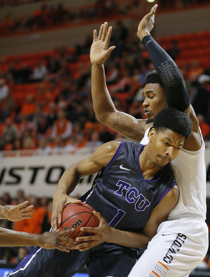 Photo - Oklahoma State's Le'Bryan Nash (2) defends TCU's Karviar Shepherd (1) during an NCAA college basketball game between Oklahoma State University (OSU) and TCU at Gallagher-Iba Arena in Stillwater, Okla., Wednesday, Jan. 15, 2014.  Photo by Bryan Terry, The Oklahoman