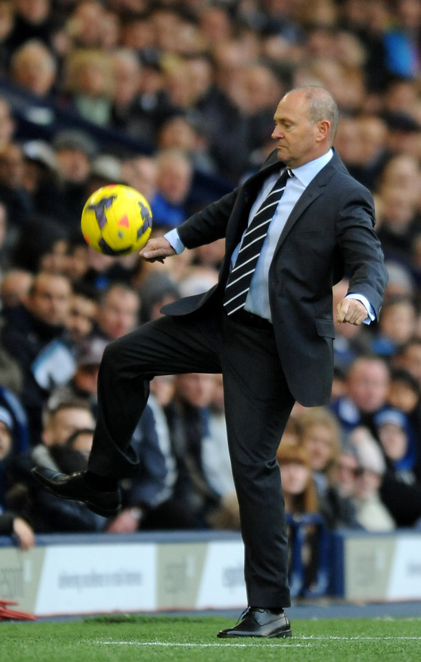 Photo - West Bromwich manager Pepe Mel retrieves the ball in the technical area during the English Premier League soccer match between West Bromwich Albion and Fulham at Hawthorns Stadium in West Bromwich, England, Saturday, Feb. 22 2014. (AP Photo/Rui Vieira)