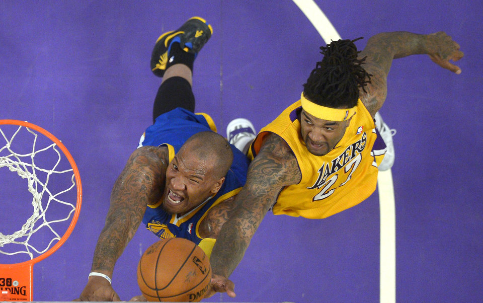 Photo - Golden State Warriors forward Marreese Speights, left, and Los Angeles Lakers forward Jordan Hill compete for a rebound during the first half of an NBA basketball game, Friday, April 11, 2014, in Los Angeles. (AP Photo/Mark J. Terrill)