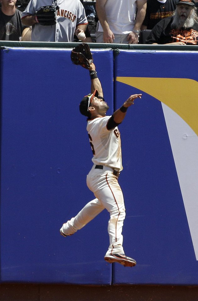 Photo -   San Francisco Giants center fielder Angel Pagan (16) jumps but cannot catch a double by Milwaukee Brewers' Taylor Green during the second inning of a baseball game in San Francisco, Sunday, May 6, 2012. (AP Photo/Jeff Chiu)