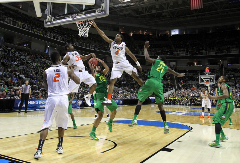 Photo - OSU's Le'Bryan Nash, Marcus Smart and Briam Williams can't come up with the rebound as Oregon's Arsalan Kazemi pulls it down in the second round of the NCAA Basketball tournament in San Jose, CA, Mar. 21, 2013. STEPHEN PINGRY/Tulsa World