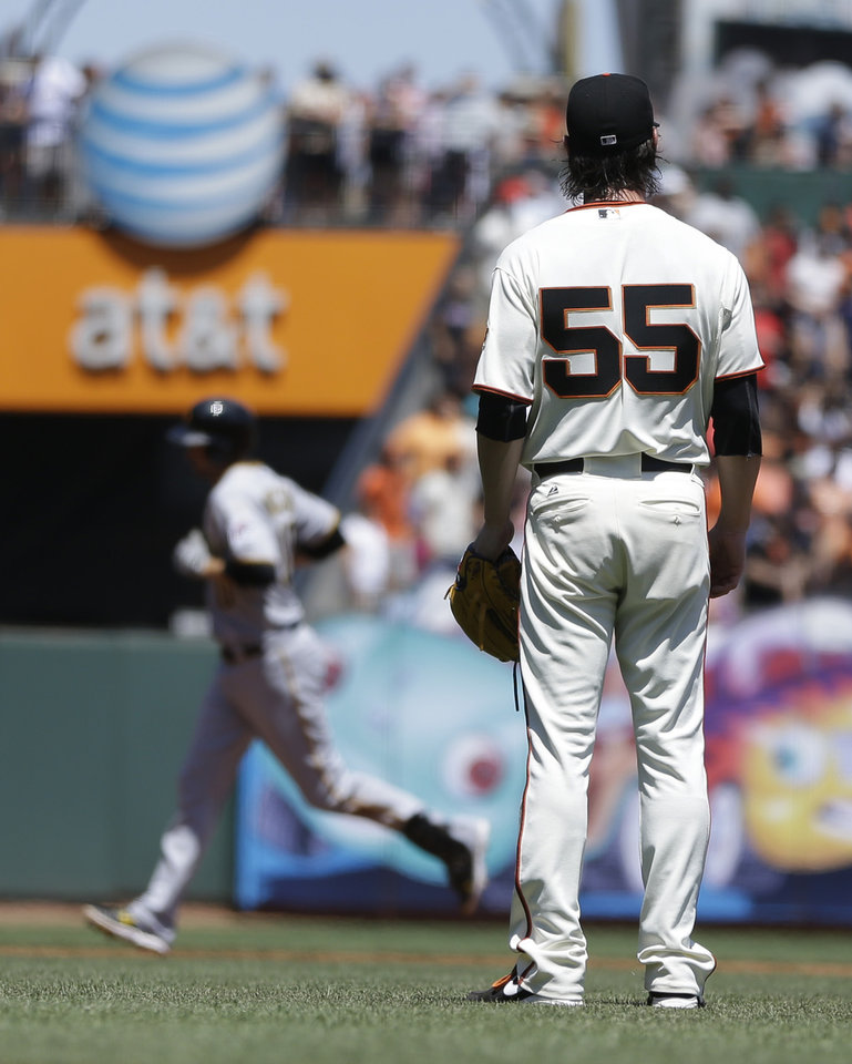 Photo - San Francisco Giants pitcher Tim Lincecum (55) waits for Pittsburgh Pirates' Jordy Mercer to run the bases after Mercer's two run home in the fifth inning of a baseball game Wednesday, July 30, 2014, in San Francisco. (AP Photo/Ben Margot)