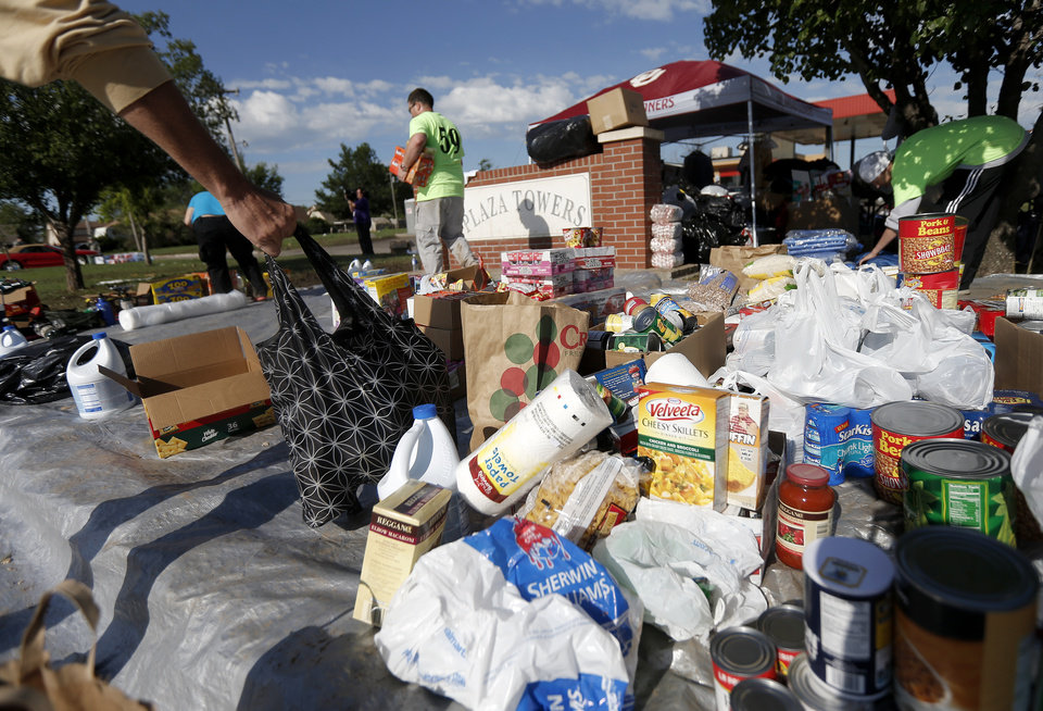 Photo - People drop off items for tornado victims outside the Plaza Towers neighborhood in Moore, Okla., on Wednesday, May 22, 2013. A tornado damaged the area on Monday, May 20, 2013. Photo by Bryan Terry, The Oklahoman