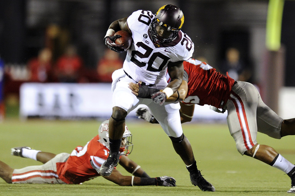 Photo -   Minnesota's Donnell Kirkwood (20) rushes against the UNLV defense during an NCAA college football game, Thursday, Aug. 30, 2012, in Las Vegas. (AP Photo/David Becker)