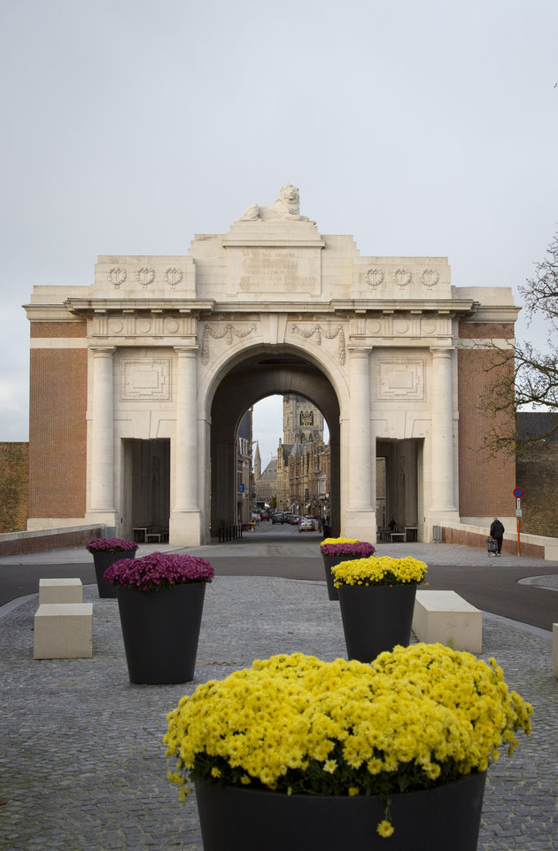 Photo - In this Nov. 9, 2013 photo, yellow flowers at the entrance of the Menin Gate in Ypres, Belgium. One hundred years after the war began, Tour de France organizers have decided to mark the anniversary with a series of stages across the northern and eastern French and Belgian battlefields where so many lives were lost. (AP Photo/Virginia Mayo)