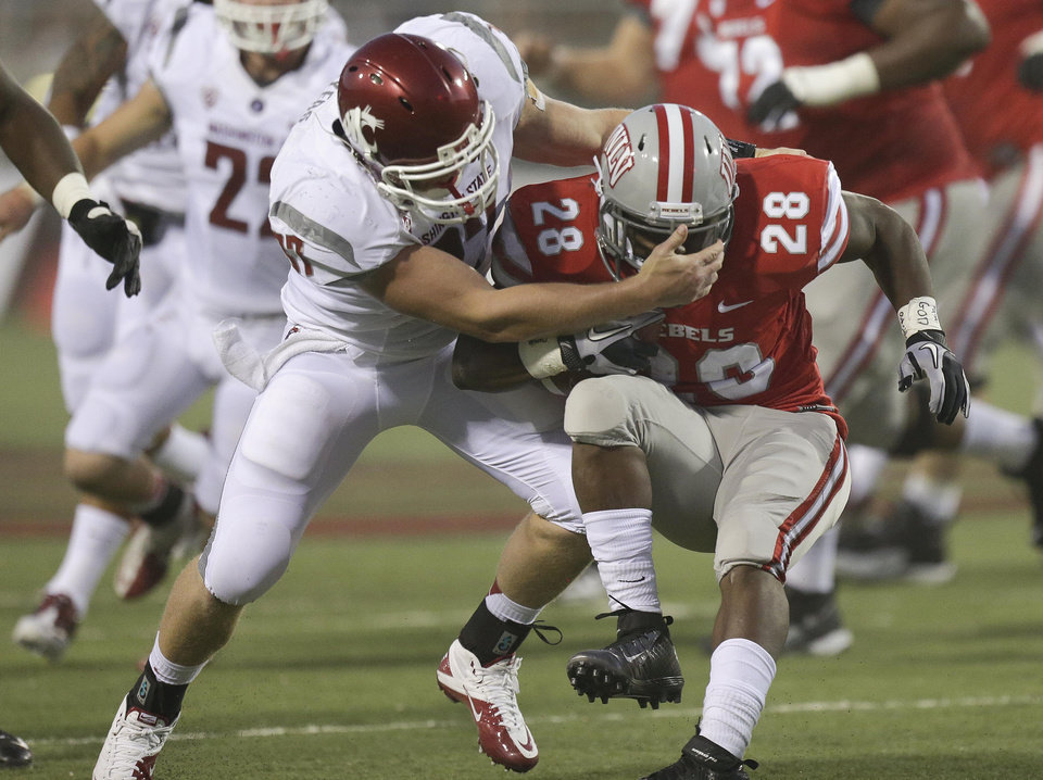 Photo -   UNLV running back Bradley Randle (28) is tackled by Washington State linebacker Jared Byers (37) in the second quarter of an NCAA college football game, Friday, Sept. 14, 2012, in Las Vegas. (AP Photo/Julie Jacobson)
