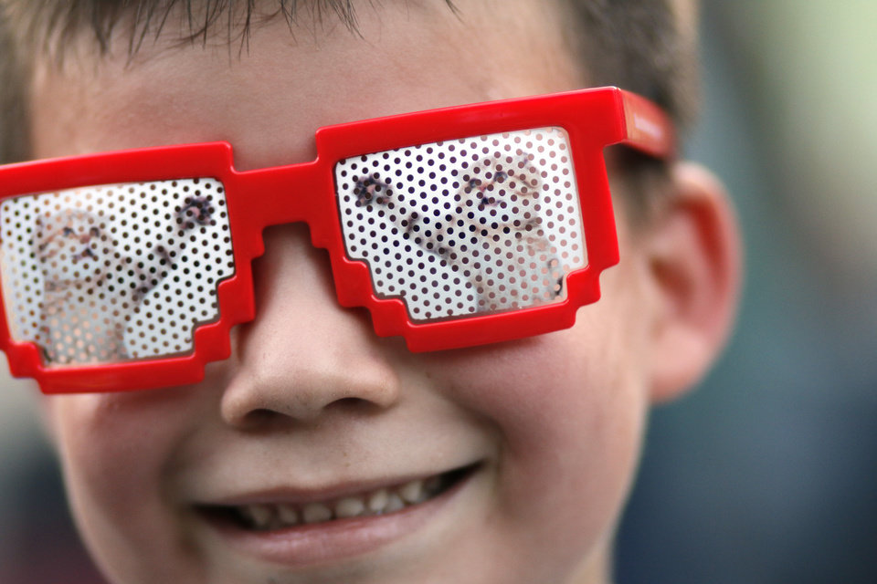 Photo - Edgar Pineda, 5, gets his cat glasses at the TFCU booth during the Internet Cat Video Fest at the Myriad Botanical Gardens Great Lawn Saturday, August 6, 2016. Photo by Doug Hoke, The Oklahoman