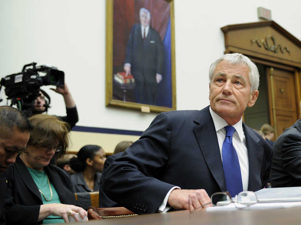 Photo - Defense Secretary Chuck Hagel arrives on Capitol Hill in Washington, Wednesday, June 11, 2014, to testify before the House Armed Services Committee. Hagel faced angry lawmakers becoming the first Obama administration official to testify publicly about the controversial prisoner swap with the Taliban. (AP Photo/Susan Walsh)