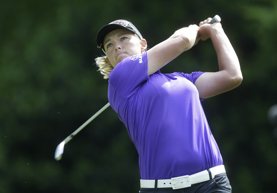 Photo - Katherine Kirk, of Austrailia, watches her tee shot on the fifth hole during the final round of the Kingsmill Championship golf tournament at the Kingsmill resort  in Williamsburg, Va., Sunday, May 18, 2014.   (AP Photo/Steve Helber)