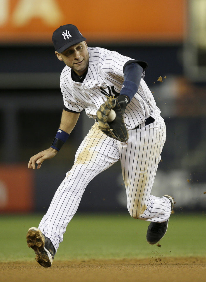 New York Yankees' Derek Jeter fields a ground ball before throwing out Detroit Tigers' Austin Jackson in the seventh inning during Game 1 of the American League championship series Saturday, Oct. 13, 2012, in New York. (AP Photo/Matt Slocum)