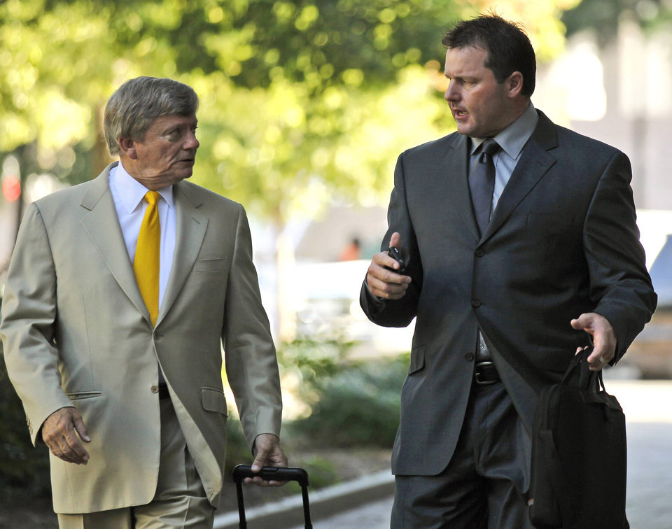 Photo -   FILE - In this July 13, 2012 file photo, former Major League Baseball pitcher Roger Clemens, right, and his attorney Rusty Hardin outside federal court in Washington. The Justice Department, embarrassed by an error that caused a mistrial of Clemens last year, has added more prosecutors in hopes of containing any missteps as it seeks to convict the famed pitcher of lying to Congress when he said he never used performance-enhancing drugs. (AP Photo/Alex Brandon, File)