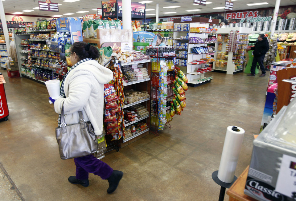 Photo - Customers shop at Supermercado Morelos on Feb. 6 in Moore.  Photo by Paul Hellstern, The Oklahoman  PAUL HELLSTERN - Oklahoman