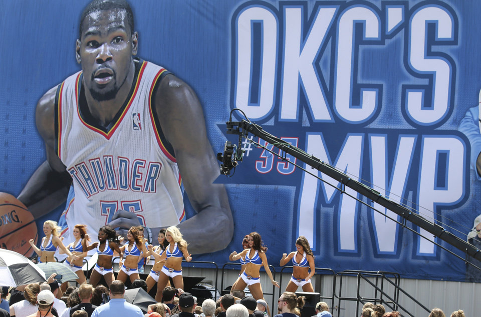 Photo - The Oklahoma City Thunder Girls perform  during a rally for Kevin Durant's MVP announcement at the Thunder Community Events Center in Edmond, Tuesday May 06, 2014. Photo By Steve Gooch, The Oklahoman
