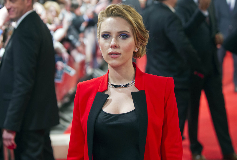 Photo - FILE - In this March 17, 2014 file photo, US actress Scarlett Johansson arrives on the red carpet for the French premiere of the film