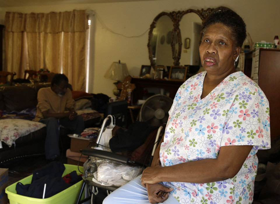 Photo - ADVANCE FOR TUESDAY, JAN. 29 AND THEREAFTER - This photo taken Jan. 18, 2013 shows part-time home health care provider Debra Walker in her home in Houston. President Barack Obama thinks his health care law makes states an offer they can't refuse. Whether to expand Medicaid _the federal-state program for the poor and disabled_ could be the most important decision facing governors and legislatures this year. The repercussions go beyond their budgets, directly affecting the well-being of residents and the finances of critical hospitals. Awaiting decisions are people like Walker, a part-time home health care provider. She had a good job with health insurance until she got laid off in 2007.  (AP Photo/Pat Sullivan)