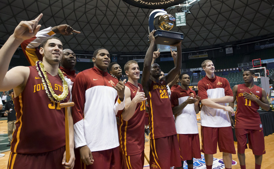 Photo - The Iowa State basketball team shows off the Diamond Head Classic championship trophy to their fans after defeating Boise State 70-66 in an NCAA college basketball game Wednesday, Dec. 25, 2013, in Honolulu.  (AP Photo/Eugene Tanner)
