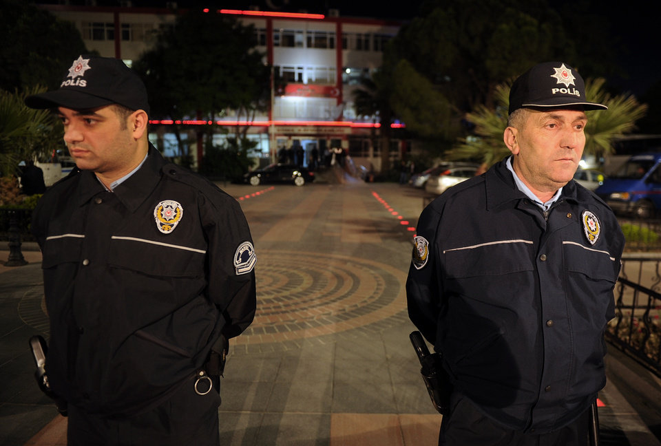 Photo - Police officers stand outside the local courthouse in the coal miners' town of Soma, Turkey, Sunday, May 18, 2014. Twenty-five people, including mining company executives, have been detained as Turkish officials investigate the mining disaster that killed 301 people, a domestic news agency reported Sunday.(AP Photo/Emre Tazegul)