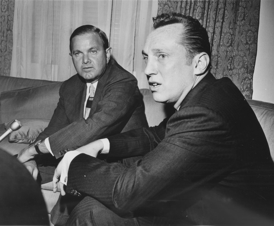 Photo - FILE - In this April 1966, file photo, Al Davis, right, the head coach-general manager of the Oakland Raiders, was named the new American Football League Commissioner in Houston by Ralph Wilson, left, President of the AFL and owner of the Buffalo Bills. Bills owner Wilson Jr. has died at the age of 95. NFL.com says team president Russ Brandon announced his death at the league's annual meeting in Orlando, Fla., Tuesday, March 25, 2014. He was one of the original founders of the American Football League and owned the Bills for the last 54 years. (AP Photo/Ed Kolenovsky, File)