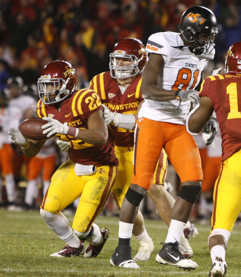 Photo - Iowa State's Leonard Johnson (23), comes up with the ball beside Oklahoma State's' Justin Blackmon (81) after an interception in the second overtime of a college football game between the Oklahoma State University Cowboys (OSU) and the Iowa State University Cyclones (ISU) at Jack Trice Stadium in Ames, Iowa, Friday, Nov. 18, 2011. Photo by Bryan Terry, The Oklahoman