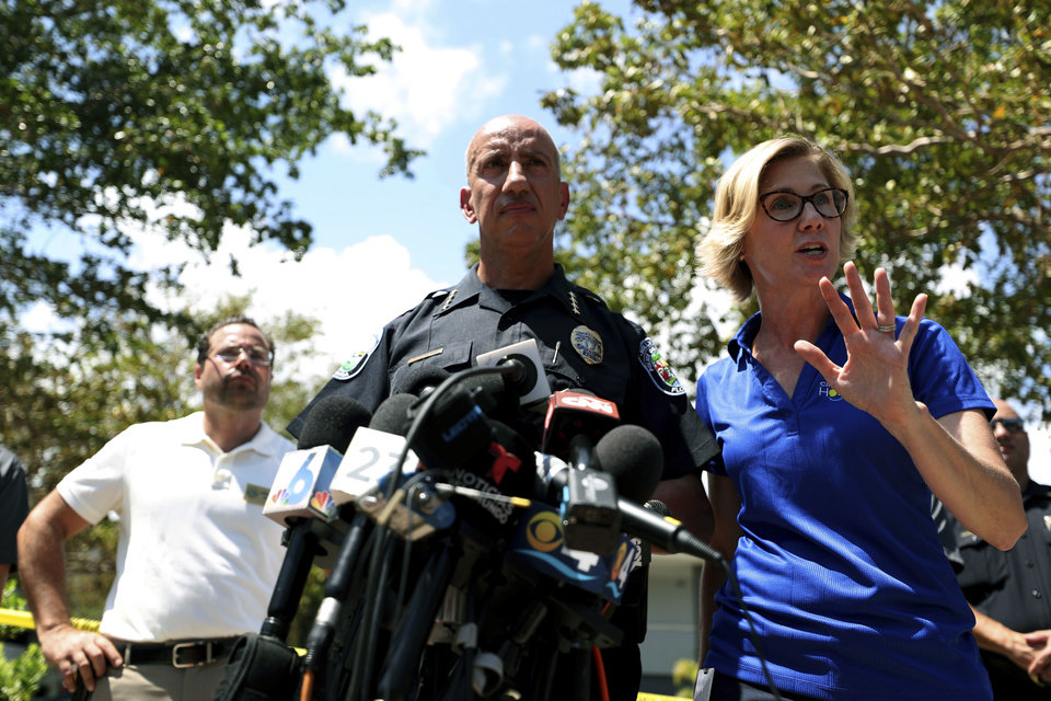 Photo - Hollywood Police chief Tomas Sanchez and Hollywood, Fla., Director of Public Affairs Raelin Storey, right, answer questions  outside the Rehabilitation Center at Hollywood Hills, Wednesday, Sept. 13, 2017, in Hollywood, Fla. Several patients at the sweltering nursing home died in Hurricane Irma's aftermath, raising fears Wednesday about the safety of Florida's 4 million senior citizens amid widespread power outages that could go on for days. (John McCall/South Florida Sun-Sentinel via AP)